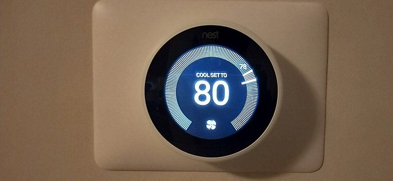 Nest learning thermostat in living room